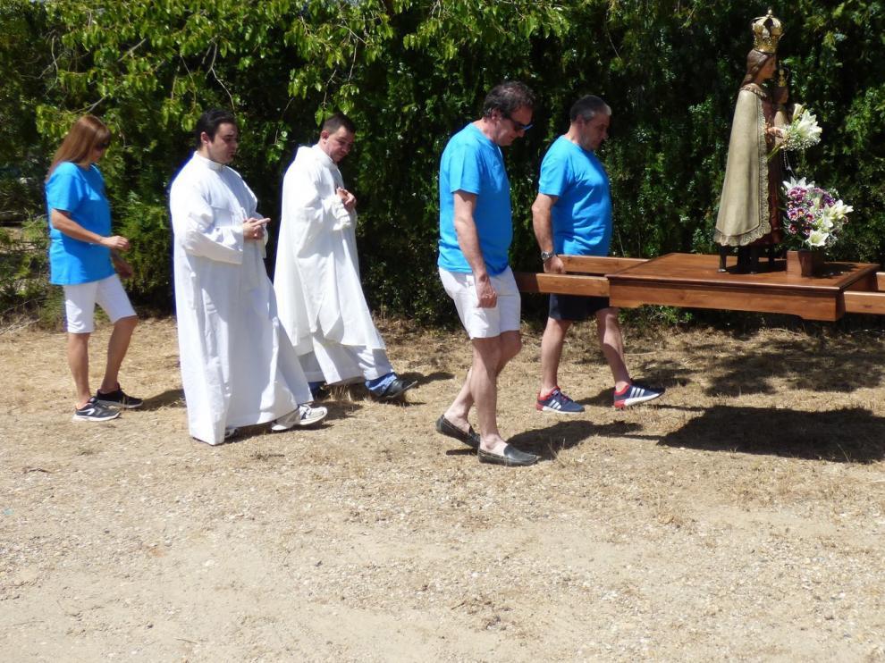 Calor y buen ambiente popular en la romería de la Virgen del Plano