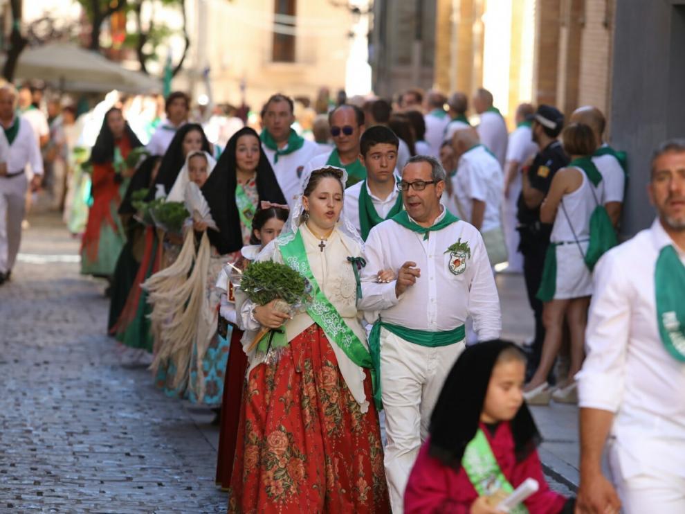 Devoción y política se acaban mezclando en la tradicional procesión de San Lorenzo