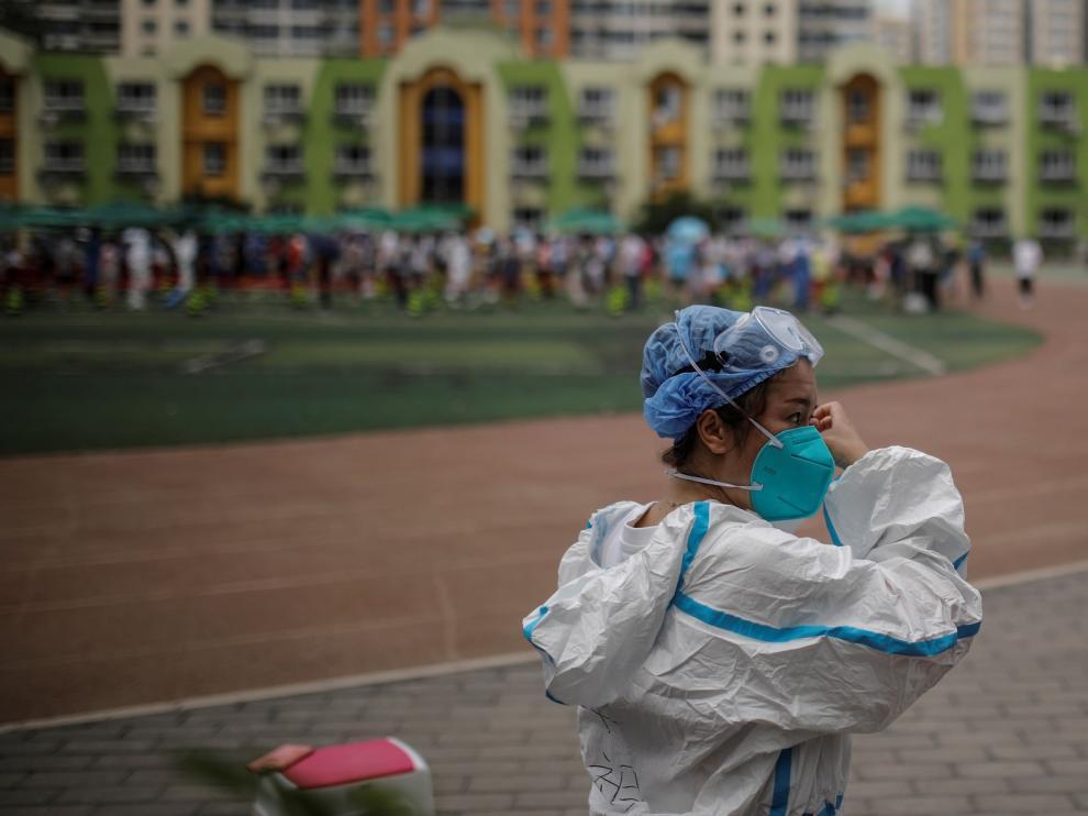 Pekín reduce los nuevos casos den covid y realiza pruebas a más de dos millones de personas