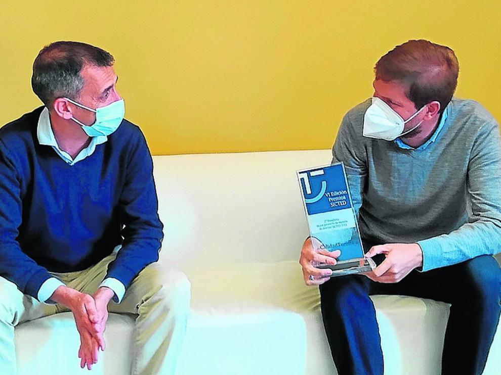 El consultor responsable del Sicted, Marc Pavía y el presidente ribagorzano, Marcel Iglesias.