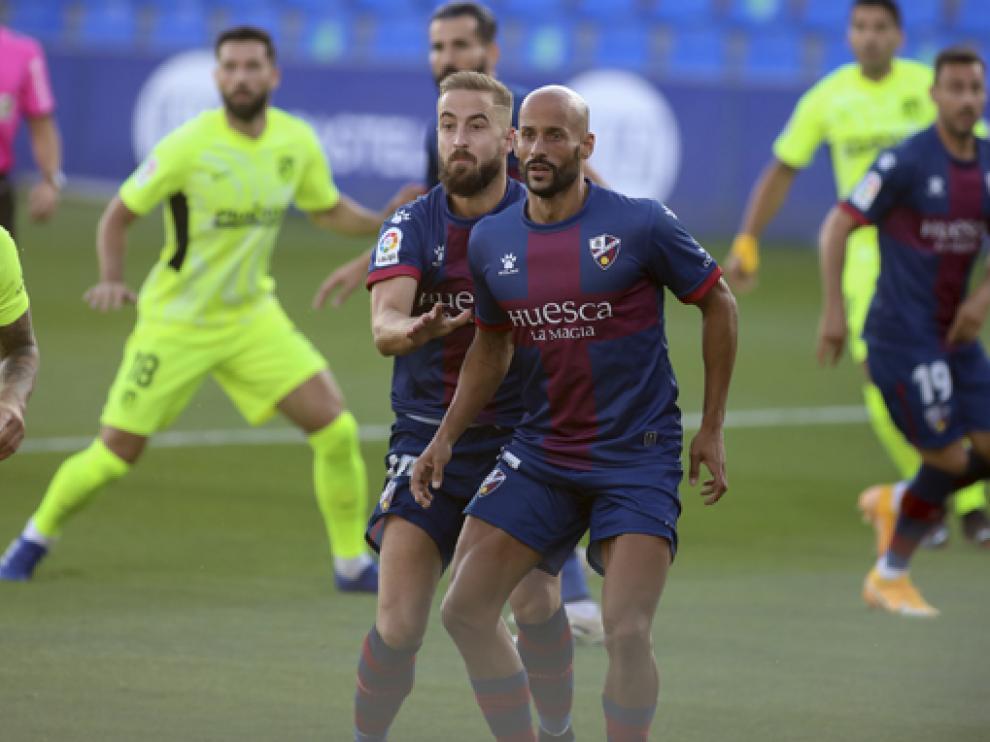 Jorge Pulido y Mikel Rico continuarán capitaneando al Huesca.