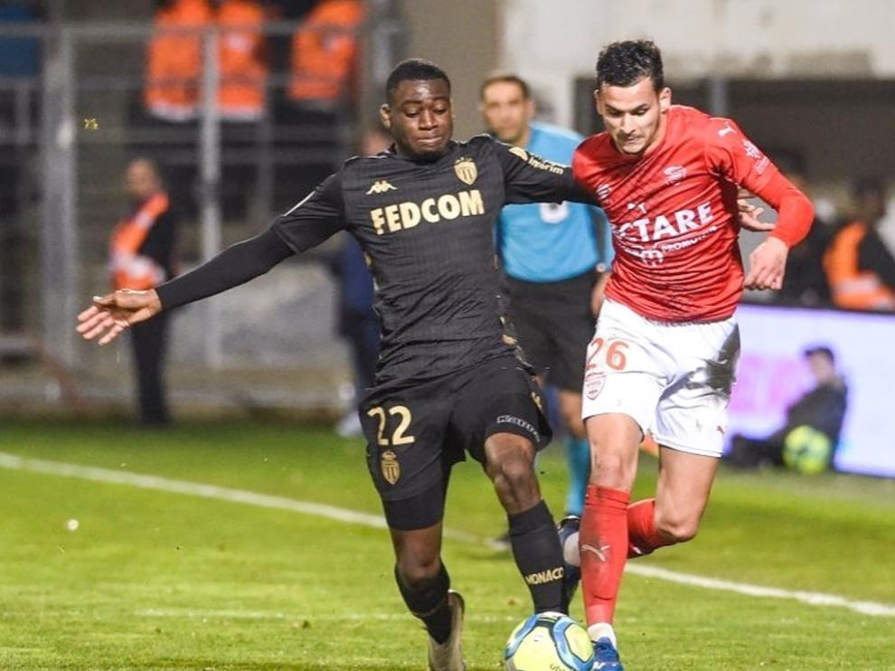 Florian Miguel, a la derecha, en un partido con el Nimes ante el Mónaco