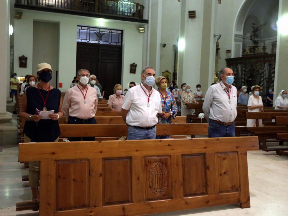 Asistentes a la eucaristía en la Basílica de San Lorenzo